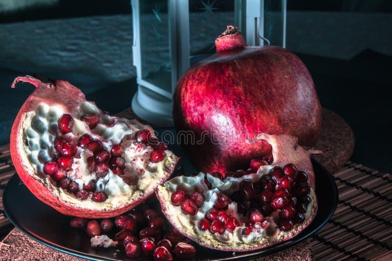 Still life with pomegranate and lantern. Still life with pomegranate. Juicy taste of the pomegranate. Freshness of summer. Fruits. Fruit freshness. pomegranate stock image