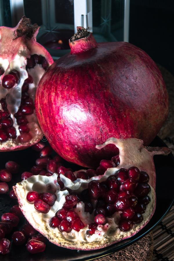 Still life with pomegranate and lantern. royalty free stock photo