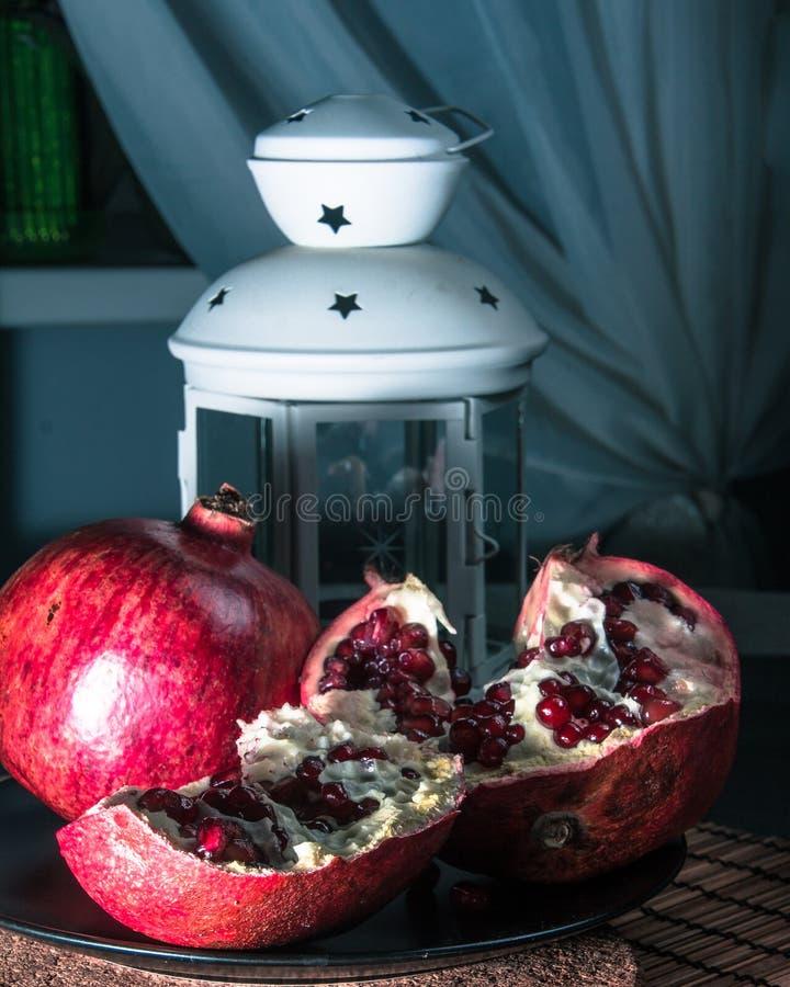 Still life with pomegranate and lantern. Still life with pomegranate. Juicy taste of the pomegranate. Freshness of summer. Fruits. Fruit freshness. pomegranate stock photography