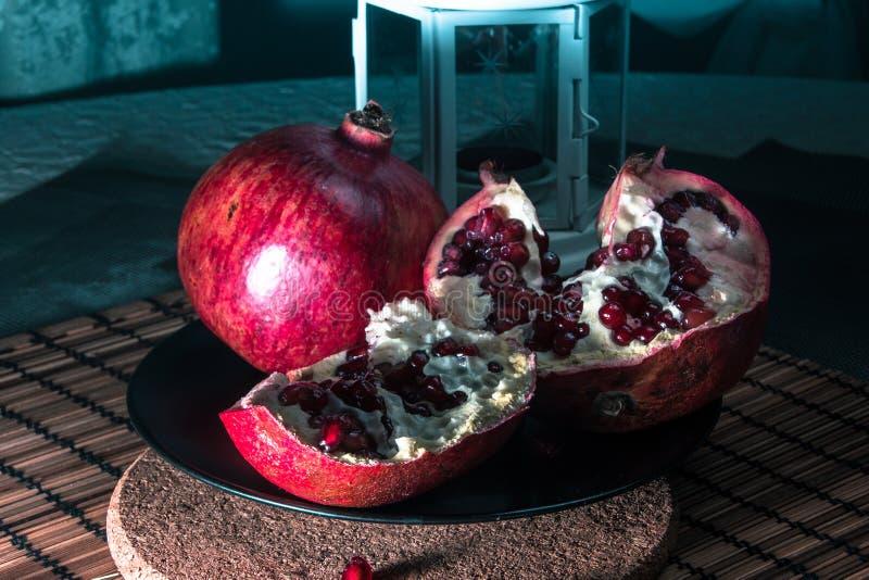 Still life with pomegranate and lantern stock photos