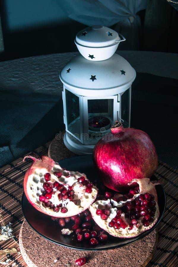 Still life with pomegranate and lantern royalty free stock photo