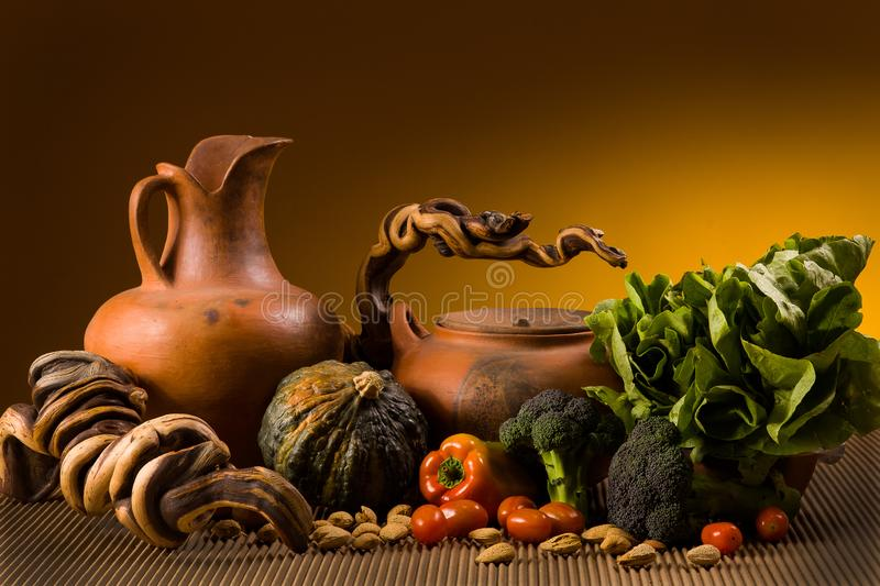 Still life with pottery and vegetables stock photos
