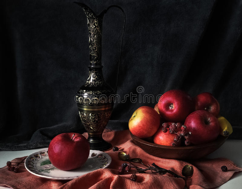 Still life with red apples,ancient jug, wooden bowl, briar,gold stock photos