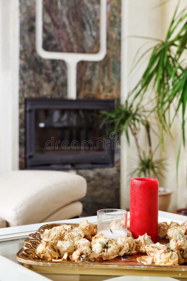 Still Life With Red Candle And Dried Rose Flowers Royalty Free Stock Images