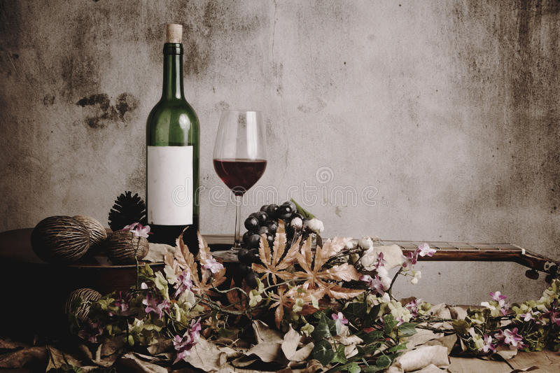 Still life of red wine bottle and wine glass. With acoustic guitar stock photos