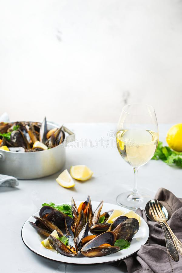 Shellfish mussels with white wine, seafood on a table royalty free stock photo