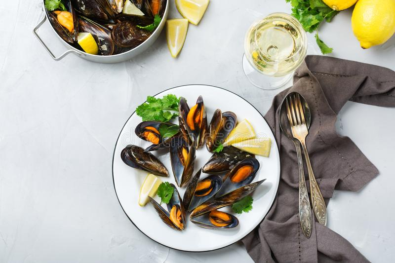 Shellfish mussels with white wine, seafood on a table stock images