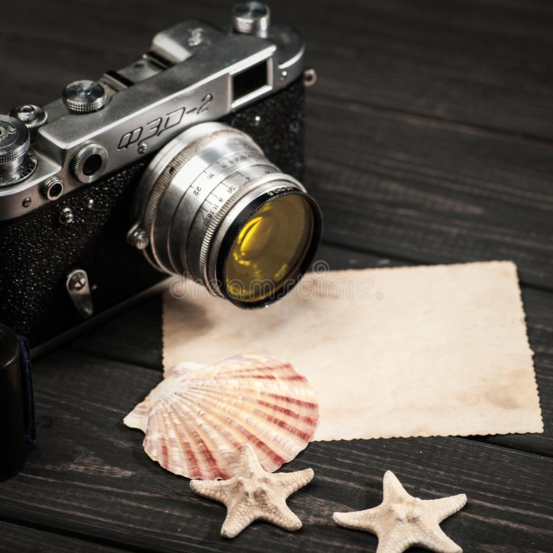Still life with retro soviet photo camera FED-2. October 23, 2017, Kiev, Ukraine. Still life with retro soviet photo camera FED-2 and lens Industar over wooden royalty free stock images