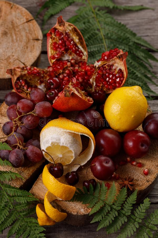 Still life with ripe juicy fruits on a wooden background in a rustic style. Concept of seasonal harvest royalty free stock photos