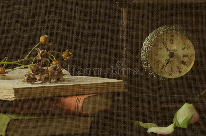 Still life. With roses and clock an books royalty free stock photography