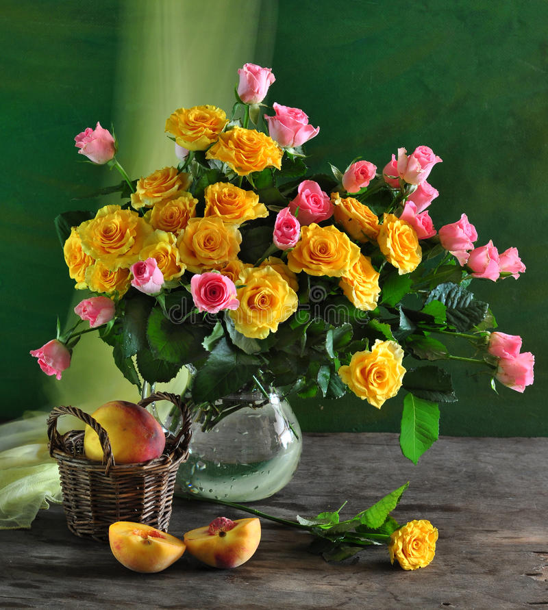 still life with roses and peach stock photography