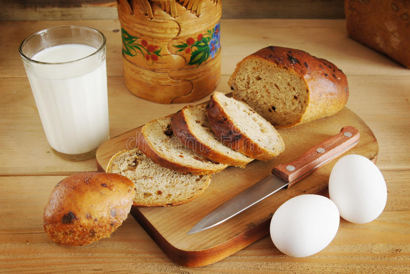 Still life with rye bread and a glass of milk stock photo