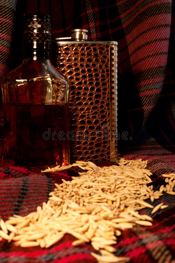 The still life with the scotland whiskey bottle and flask royalty free stock photo