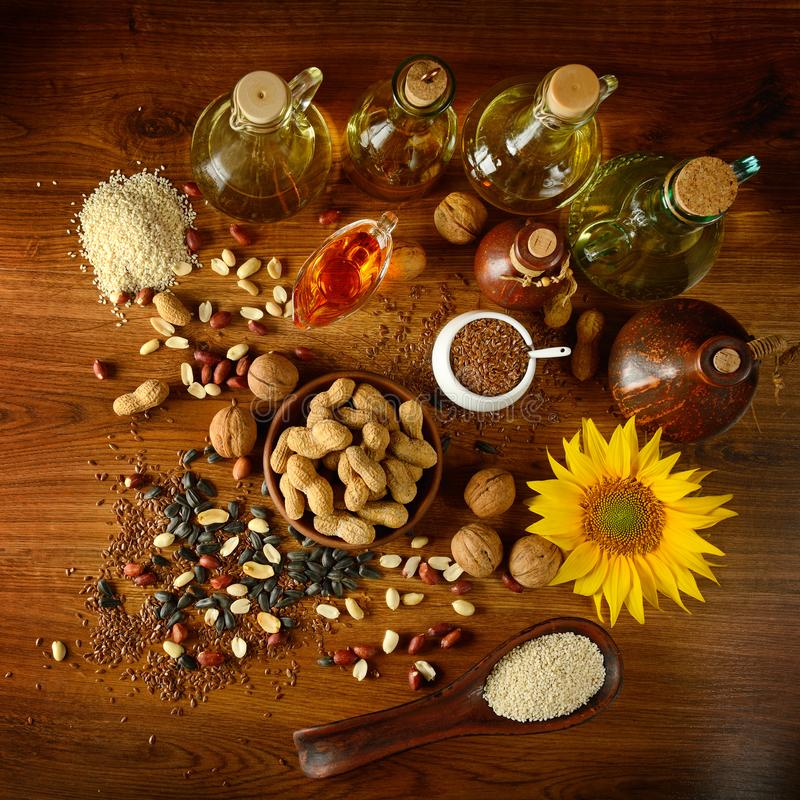 Still life seeds and oils useful for health Flax, sesame, sunfl stock images