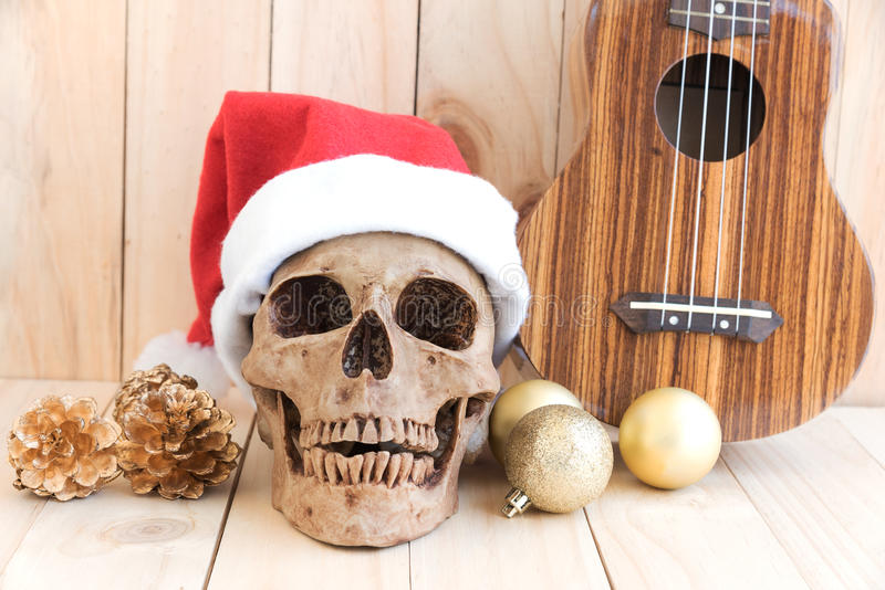 Still life with skull, ornament and ukulele, santa is coming to. Town stock photography