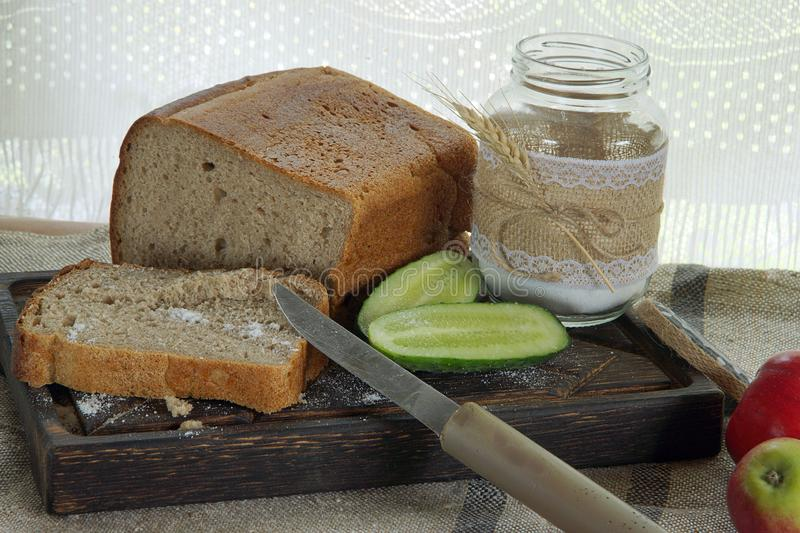 Still life on a table in the village, bread and cucumber with salt royalty free stock photo