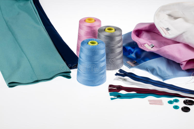 Still Life With Tailor Accessories. Different tailor accessories, pants and shirts on a studio background stock image