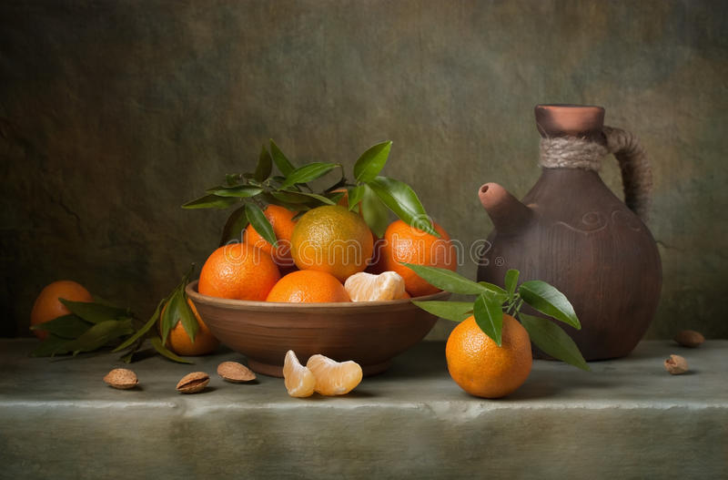 Still life with tangerines. And jug