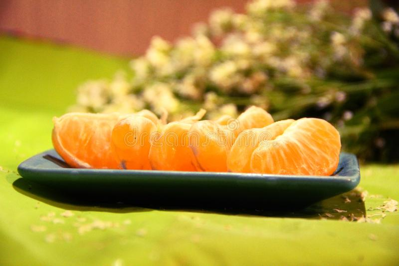 Still life: tangerines and flowers stock photo
