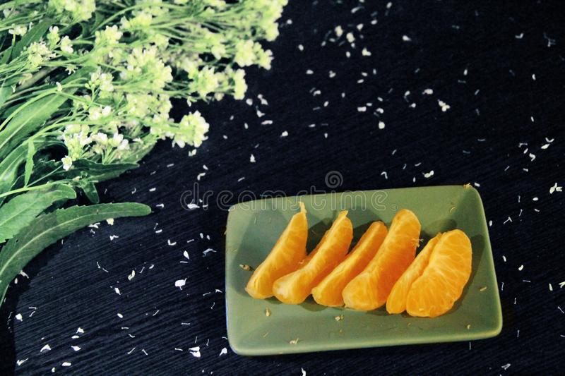 Still life: tangerines and flowers royalty free stock photography