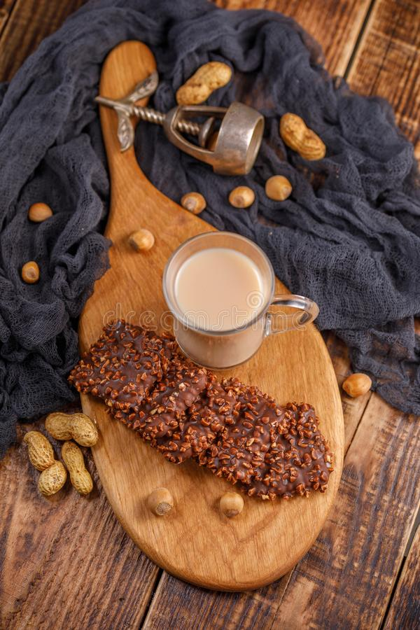 Still life with tea, biscuits, nuts and an antique walnut. Light delicious breakfast on a wooden table, top view. royalty free stock photo