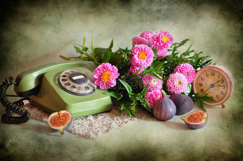 Still life with a telephone and flowers stock photo