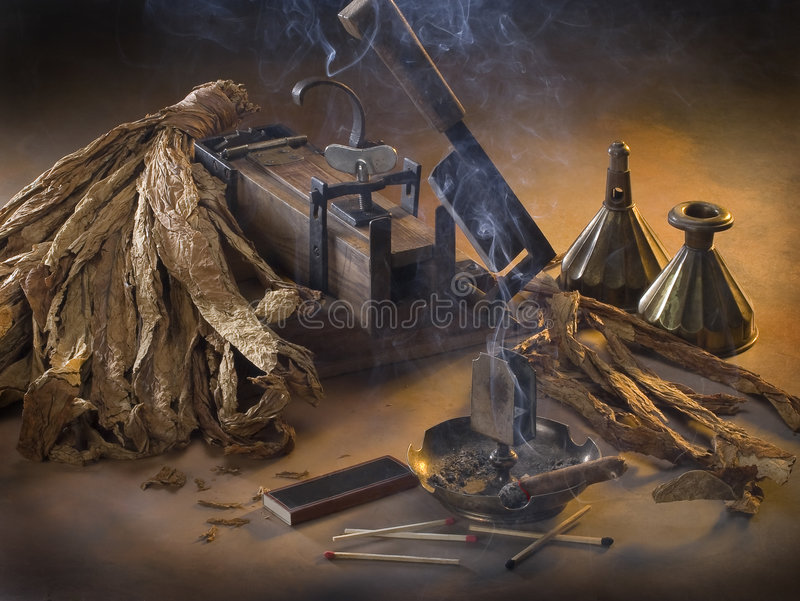 The still life with tobacco. The still life with smoke and tobacco stock photo