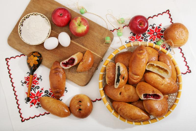 Still-life with traditional Russian Delicious pies in the basket. stock images