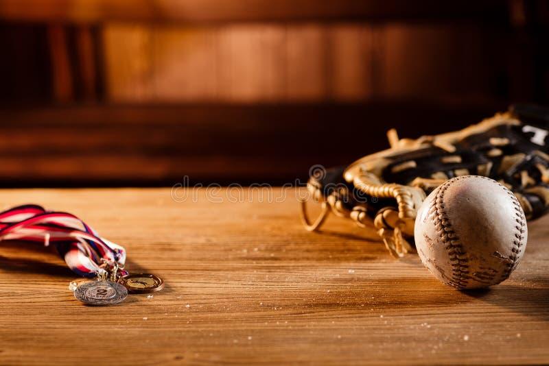 Still life of trophy, medals, vintage grunge baseball gloves stock image