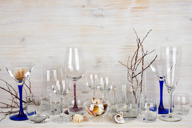 Still life of various glassware on wooden background royalty free stock photos
