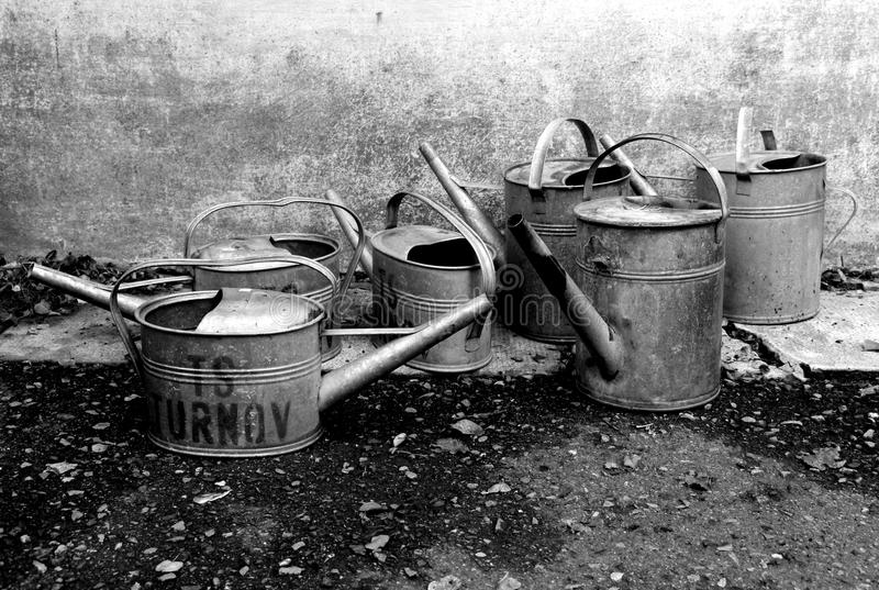 Still life with watering cans royalty free stock photo