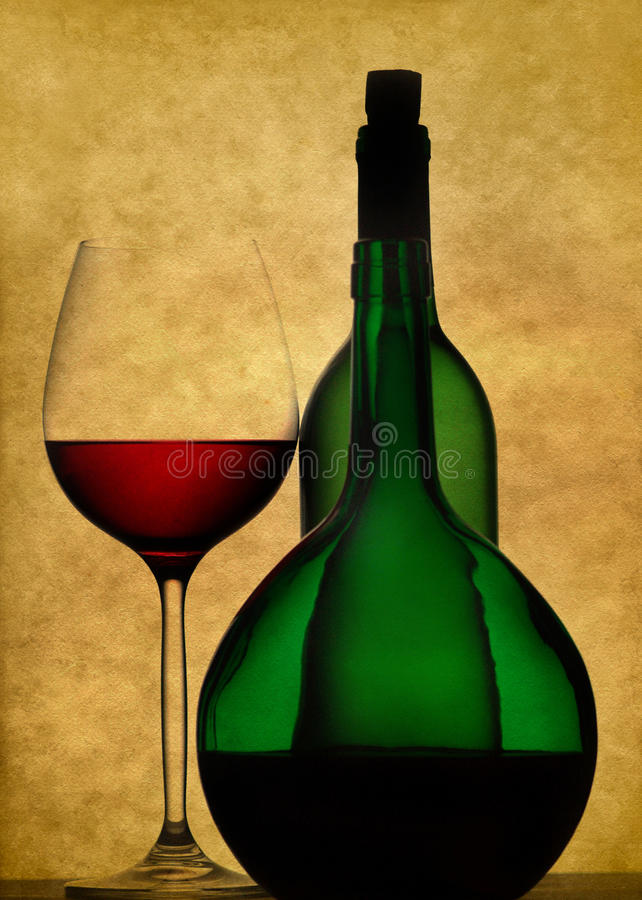 Still life with wine glass and bottles royalty free stock photos