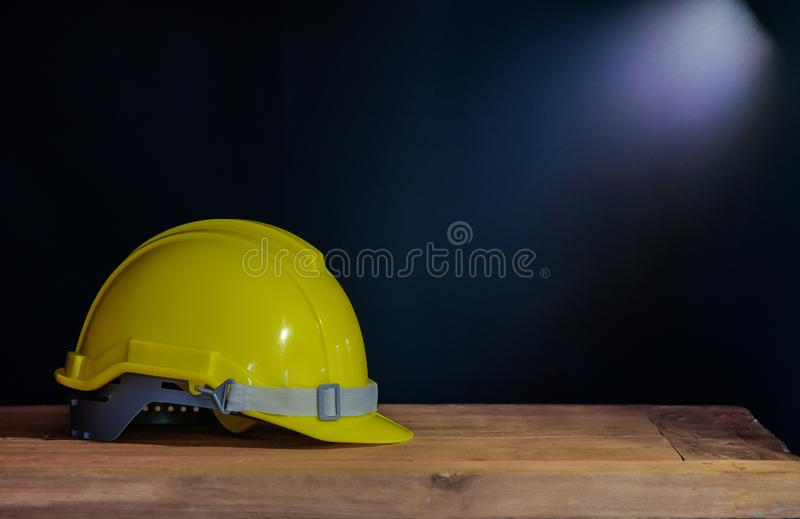 Still life yellow helmet on table stock images