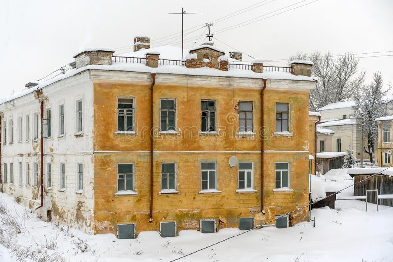 Still living old building in an old Russian small town with ruined first floor and a ground floor where people have been living. Yet in winter royalty free stock images