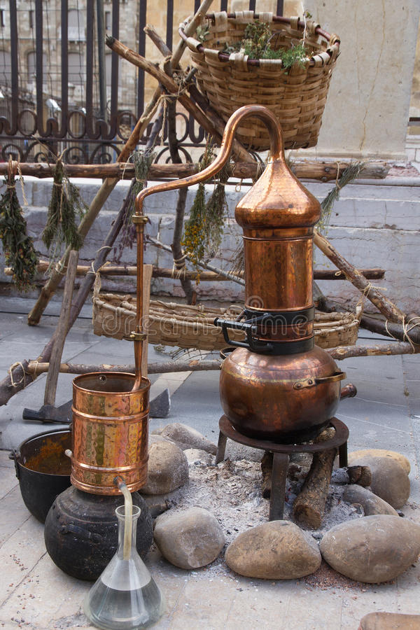 Still for perfume creation. Copper still to distill and create perfumes or essences, exposure outdoors in the laboratory or workshop simulating a perfumer stock photography