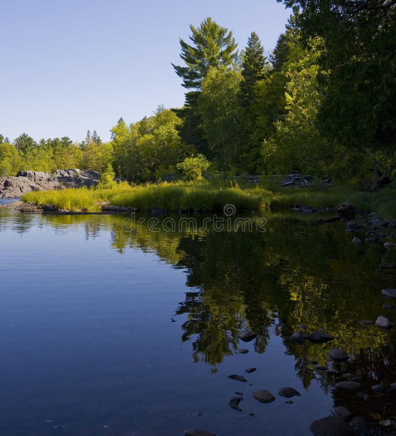 Download Still Shoreline In Green And Blue Stock Photo - Image: 6536106