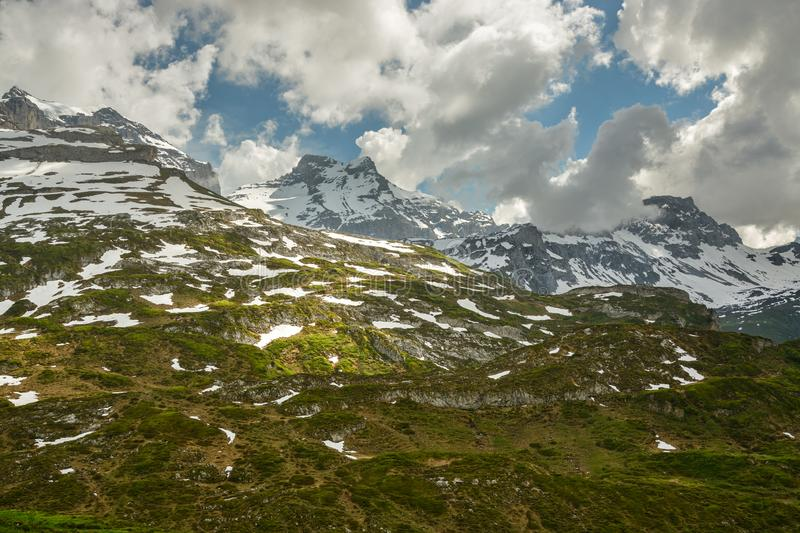 Still snowy mountains in Swiss Alps close to high alpine road Klausenpass royalty free stock photos
