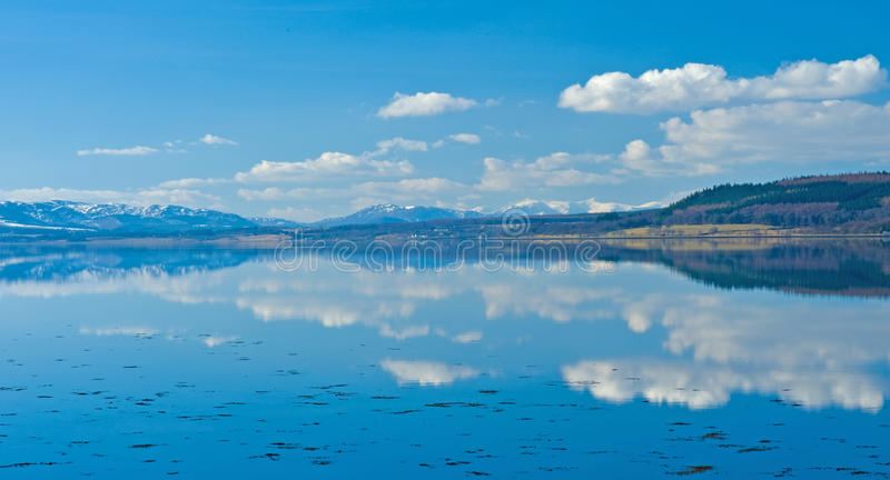 Still waters with strong reflections. royalty free stock photo