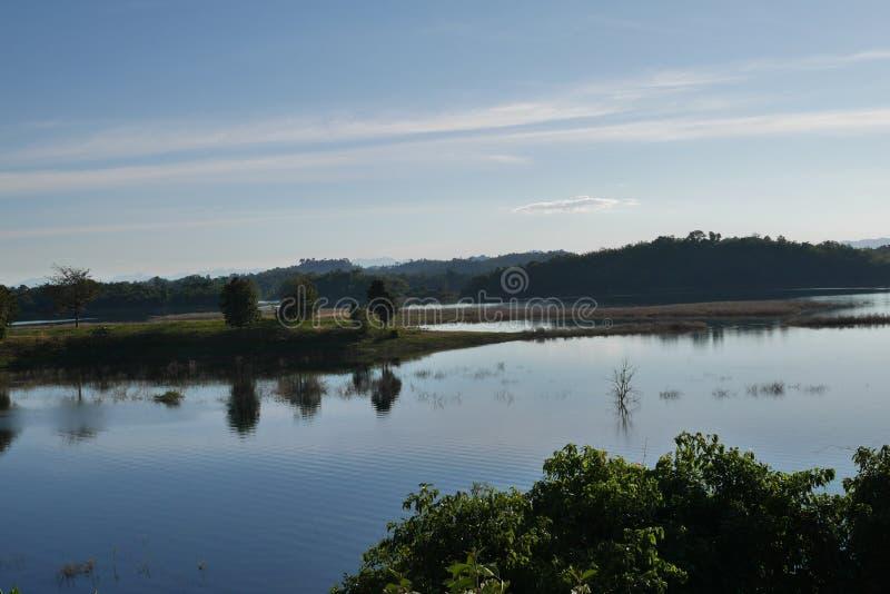 Still waters, reflections on lake Vajiralongkornin in Kanchanaburi, Thailand royalty free stock photography