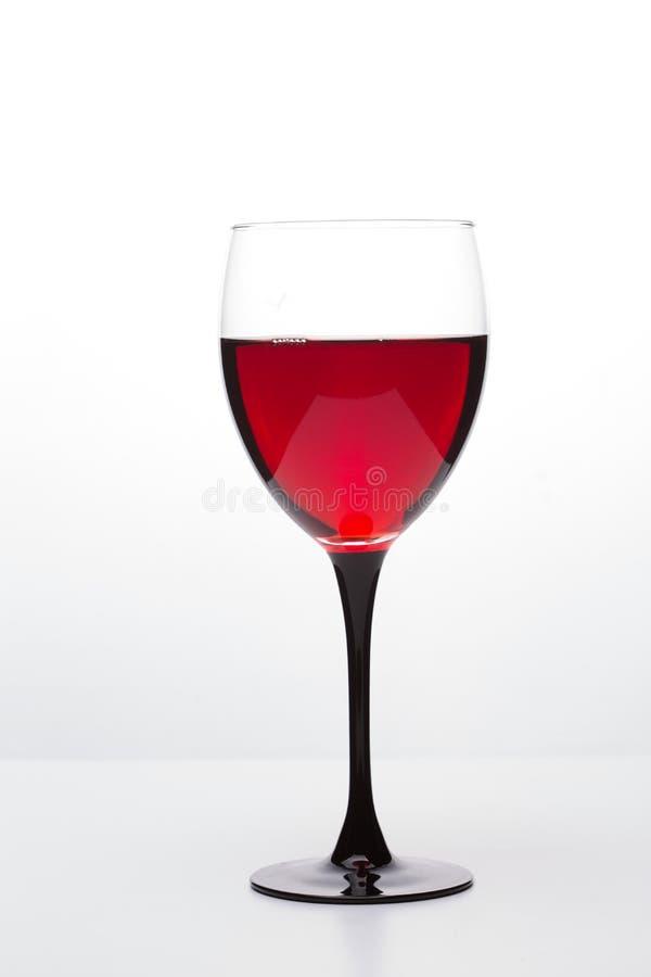 Stilleben med vinexponeringsglaset på wight arkivbilder