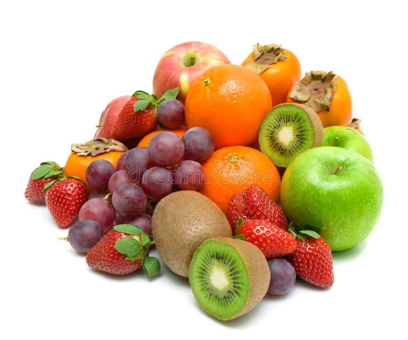 Stilleben. ny frukt på en vitbakgrund. arkivfoto