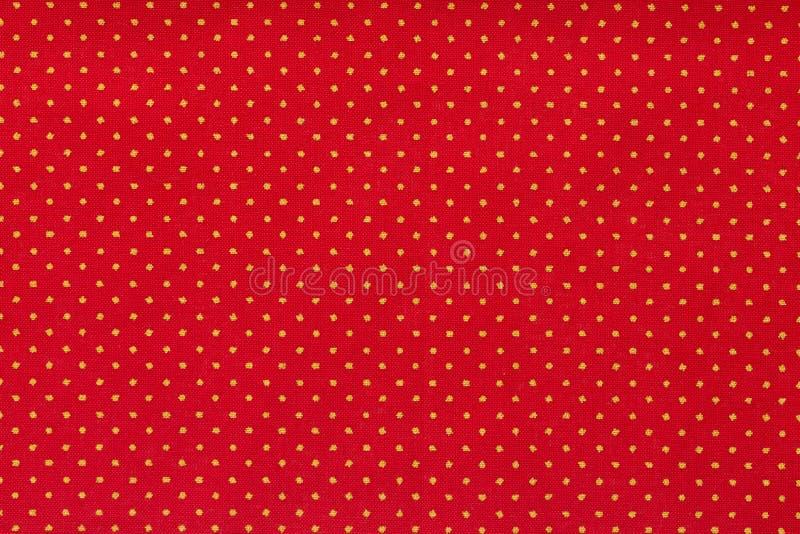 Stilleven dicht omhooggaand detail van een helder rood stuk van document met gerichte witte stippen en textuur royalty-vrije stock foto