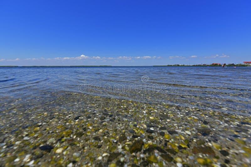 Stillhet i havsfjärden Spottade Berdyansk lokaliseras i norden av det Azov havet royaltyfria bilder