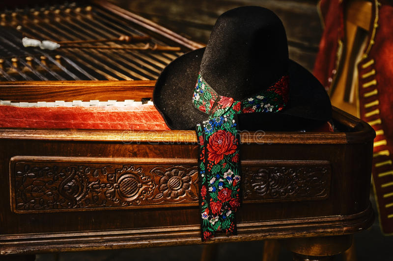Stillife with cimbalom and hat. Stillife with cimbalom in outdoor-museum stock photos