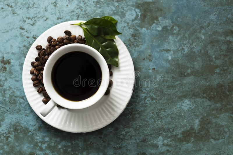 Roasted Coffee Beans. A stillife shot of the product from the coffea arabica plant, divided into to as roasted coffee beans and coarse ground coffee. nA great royalty free stock image