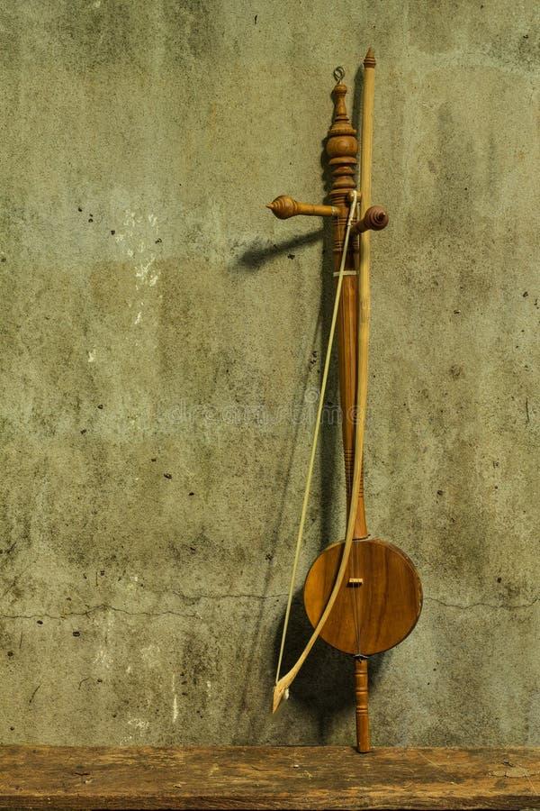 Stillleben saloa - thailändisches Musikinstrument lizenzfreie stockfotos