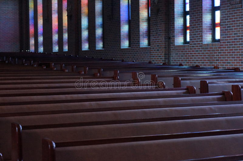 Stillness : stainglass colors reflection in the church stock images