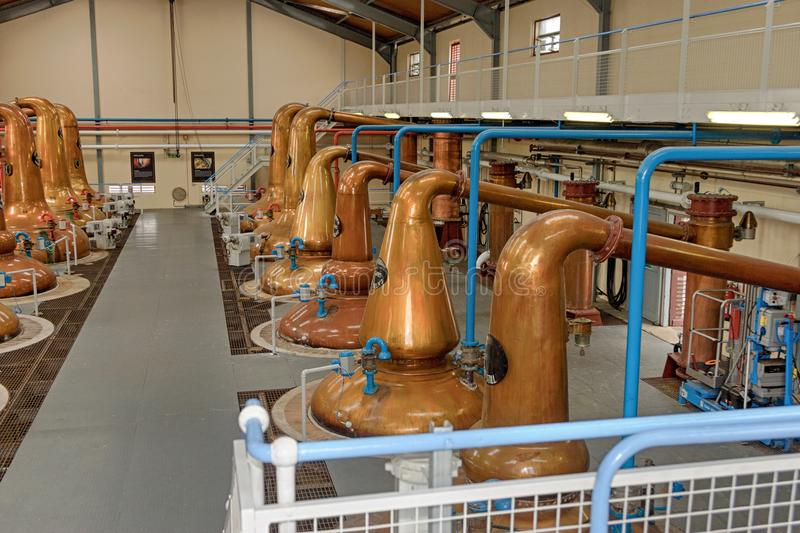 Stills for whiskey in a big distillery stock photography