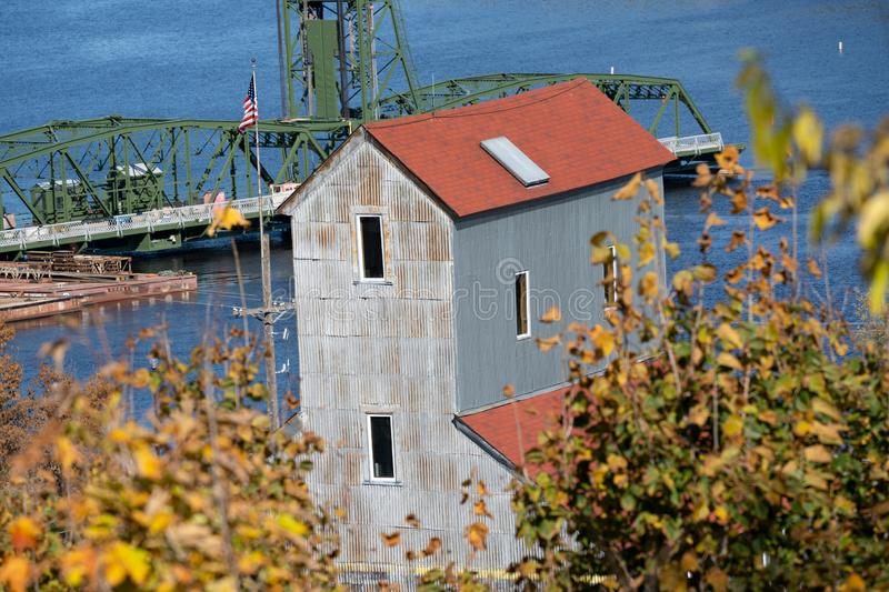 Stillwater, Minnesota in the fall - overlooking an old mill with fall leaves and the lift bridge on the St Croix River.  royalty free stock photo