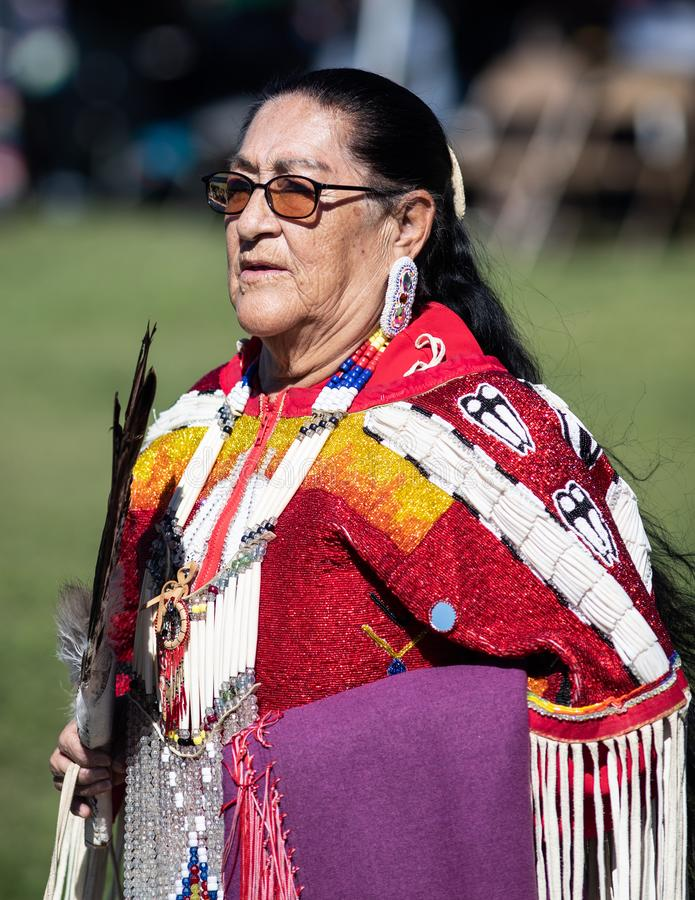 Stillwater Pow Wow Senior Dancer. Participant dancing Native American style at the Stillwater Pow Wow in Anderson, California stock image